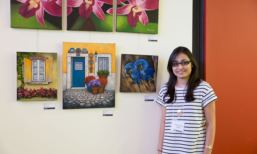 UTM alumna Christine Lobo combines realism and cartoons to produce brightly coloured paintings.